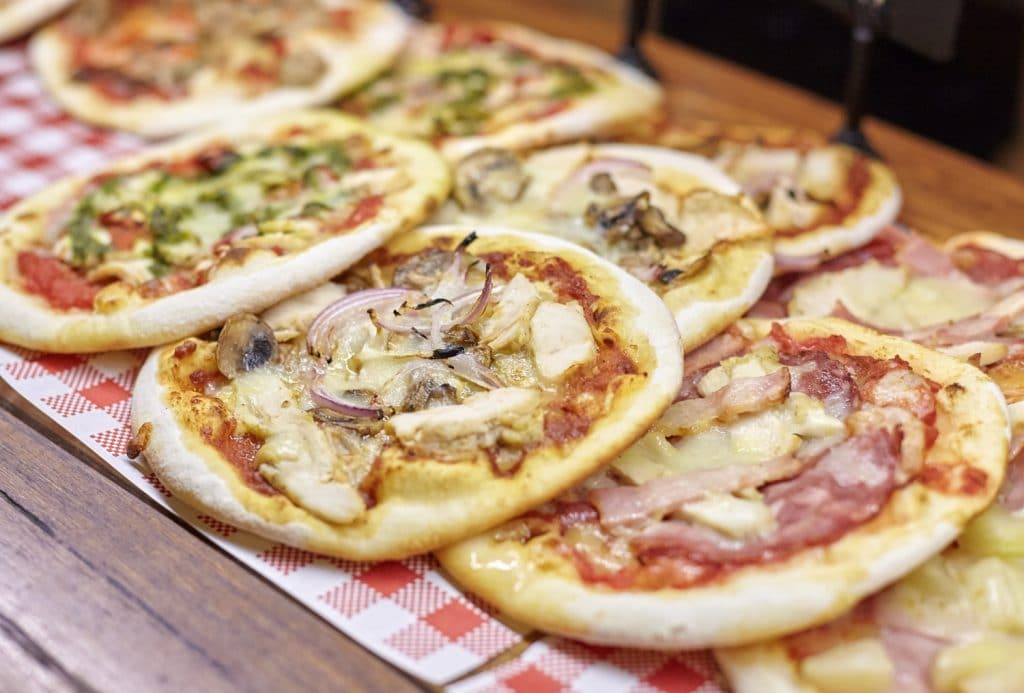 Close-up image of various 11 Inch Pizza's