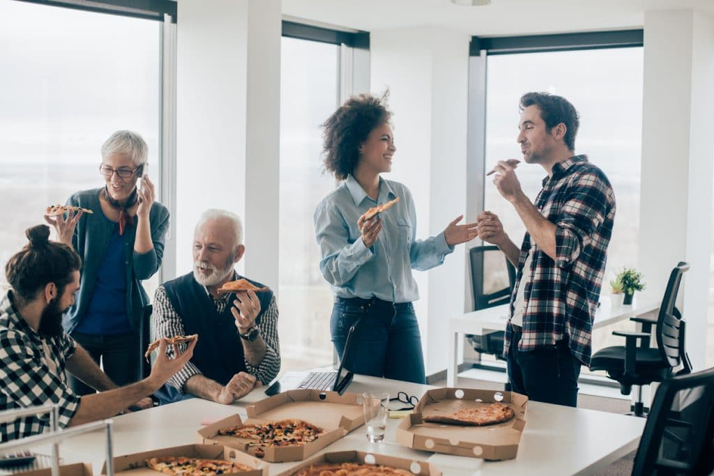 Corporate catering - Customers enjoying Pizza