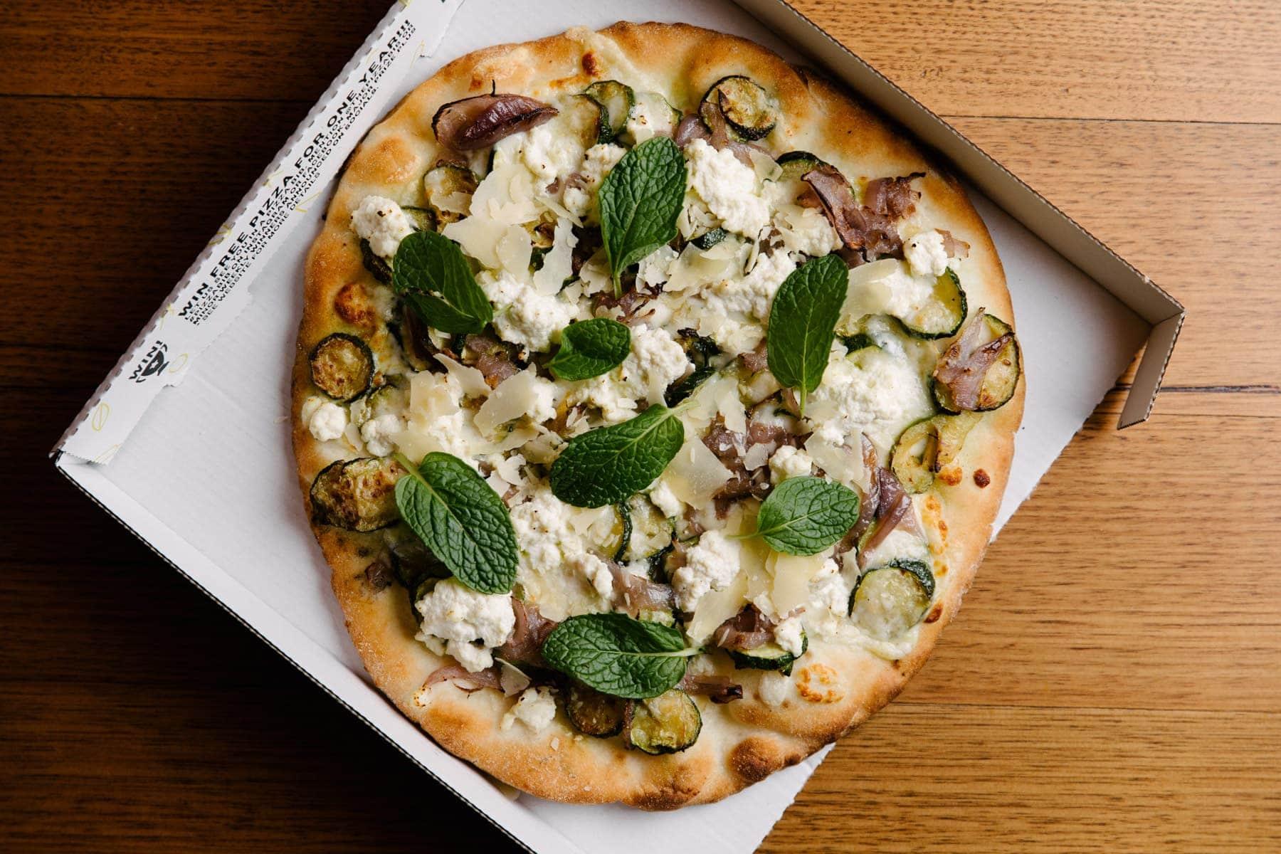Ricotta Pizza - Mozzarella / Fresh Ricotta / Zucchini / Mint / Caramelised Onions / Shaved Parmesan / Provolone