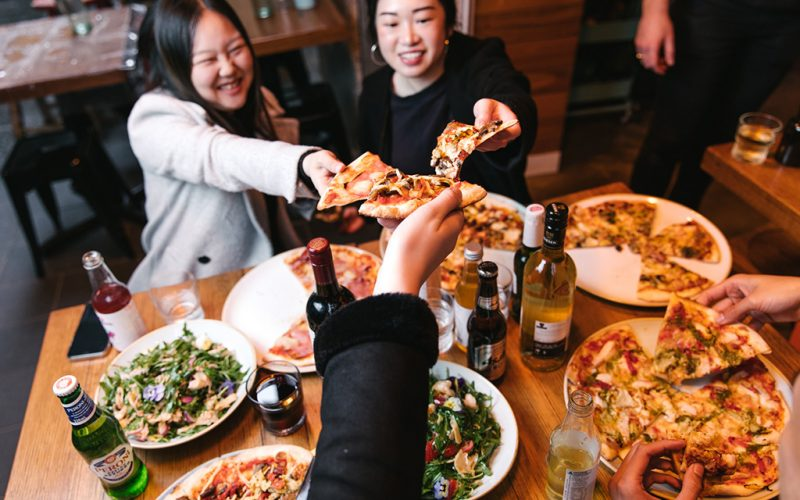 11 Inch Pizza - Group eating pizza - pizza cheers
